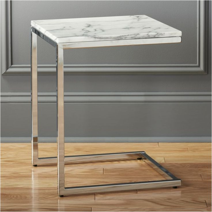 Shop smart marble top c table.   Sidekick to our smart round marble coffee table.  The taller but smaller of the two pulls armside/bedside in an open box of slick polished chrome topped flush to the edge in Carrara-style white/grey marble.