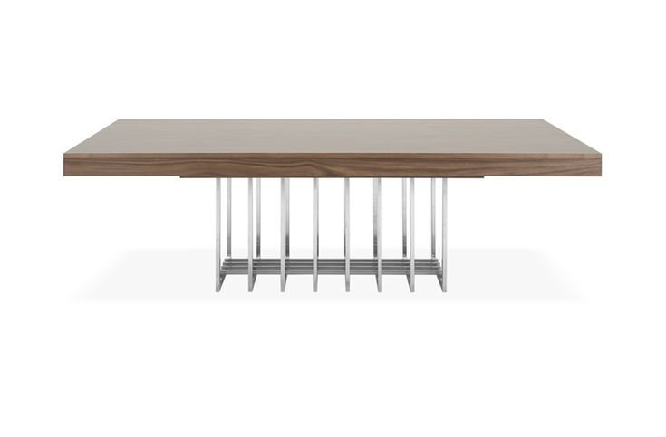 A statement addition to any scheme, the opulent Gatsby dining table commands attention. Featuring a matte walnut veneer, the geometric detailing of its brushed stainless steel base adds a contemporary element to the classic structure of this dining table.