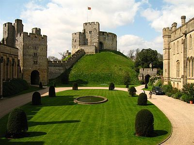 Arundel Castle: a restored and remodeled medieval castle in Arundel, West Sussex, England. It was established by Roger de Montgomery on Christmas Day 1067. Roger became the first to hold the earldom of Arundel by the graces of William the Conqueror. The castle was damaged in the English Civil War and then restored in the 18th and 19th centuries. - Wikipedia