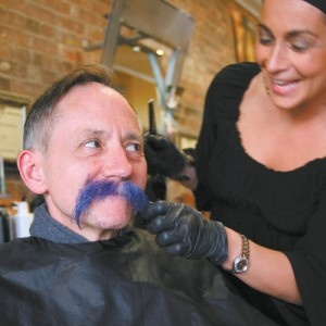 Teacher Andrew McKenzie agreed to turn his white mustache bright blue if students raised 200 dollars for charity: water