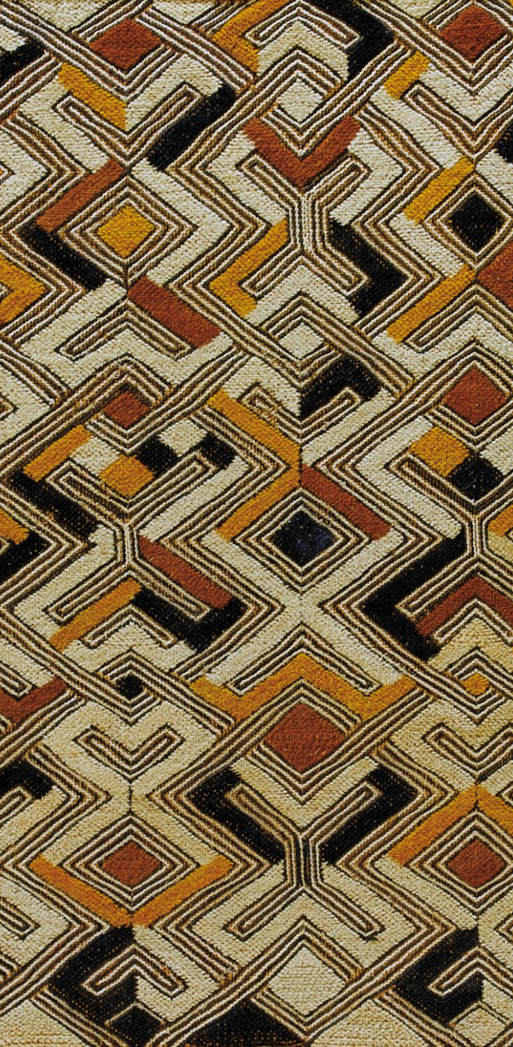 Detail from an 'nbol' from the Shoowa Kuba people of DR Congo. Raffia, embroidered with black yellow and ochre colours.