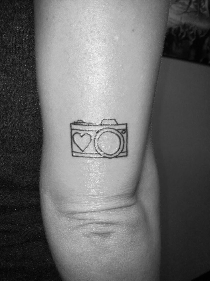 Small camera tattoo above my elbow.