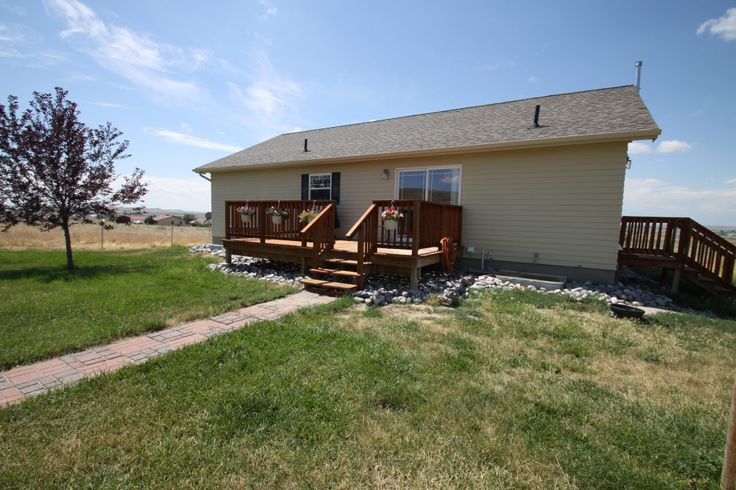 This home at 219 Lost Wells Butte Drive features 5 bedrooms, 2.5 baths, two living spaces, and an oversized two-car garage. There's a lot more, too! Call Wind River Realty at 307-856-3999 for more details!