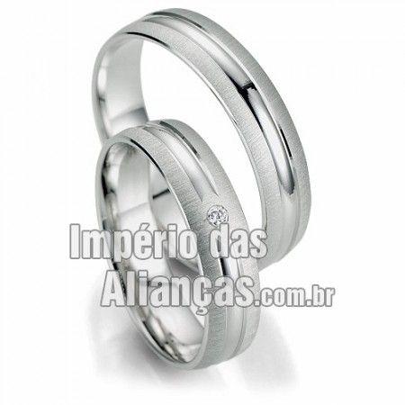 Aliança de noivado e casamento em ouro branco 18k Largura 4.5mm Pedras 1 diamante de 1,5 pontos Acabamento Fosco e Liso Peso 8 gramas O PAR