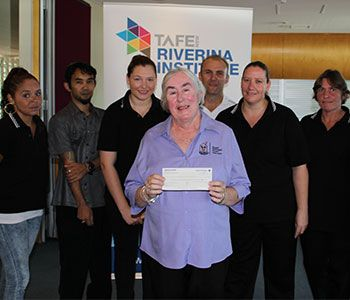 Cheque donated to Ronald McDonald House Wagga Wagga - Riverina TAFE
