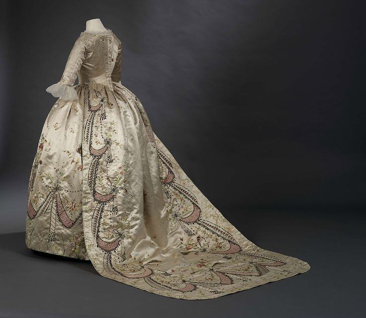"""Grand habit"" or court robe with train, ""en fourreau"", and petticoat, said to belong to Marie-Antoinette of France  Attributed to the dressmaker Marie-Jean ""Rose"" Bertin (1747 - 1813)  Silk satin, applique, embroidered with metal threads, chenille, sequins and applied glass pastes  1780's, altered in 1870's"