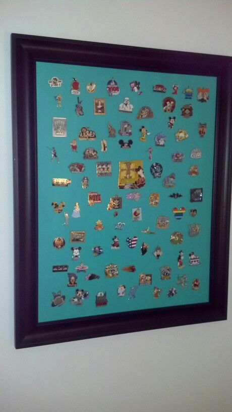 This is the display I made for my Disney pins. Take a blank art canvas and paint it, add frame and hanging hardware. The pins push through and are secured by the original backs. A great way to enjoy them.