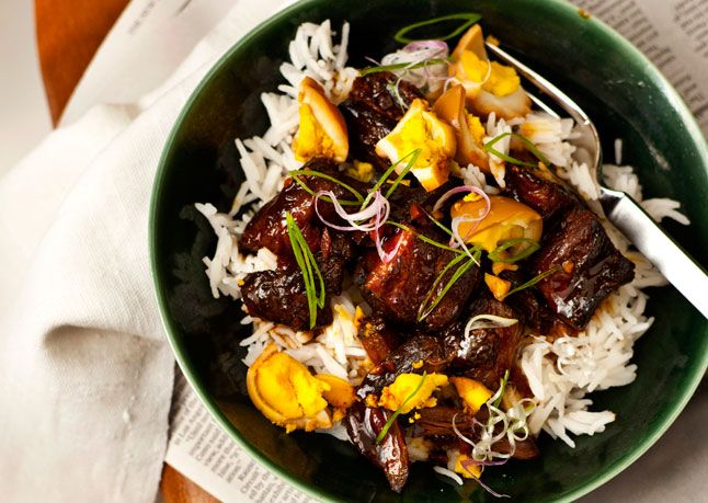 """Burmese Red Pork Stew  John Gorham, chef at Tasty n Sons in Portland, OR, knew he'd scored when his friends raved about the soulful dish of meltingly tender spiced pork and briny pickled eggs he served them one night. """"The next morning, I made a pot of rice and thought, Wow, this combination would be such a great breakfast."""" Indeed it is, no matter what time of day you eat it."""