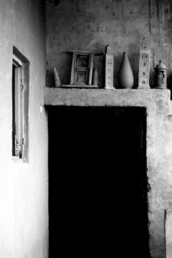 Mud house visited in Morocco..... I like the shelving above the door.