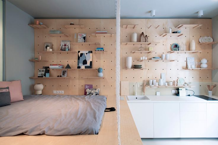 A peg wall is one of the greatest DIY flexible storage solutions! I love that this one transitions from the bedroom area to the kitchen in this open plan apartment.
