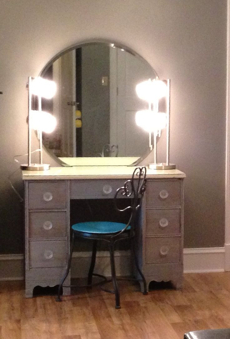 #DIYmakeupvanity.  Refinish old desk, 2 lamps from Wal-Mart, wall mounted mirror from EBay, knobs and chair from Michael's, mounted power strip under front of desk for easy on/off for lights, hair appliances, etc.  Don't forget to have a piece of glass cut for the top for when you spill makeup or fingernail polish (best $ ever spent)!  #Teengirlbedroom