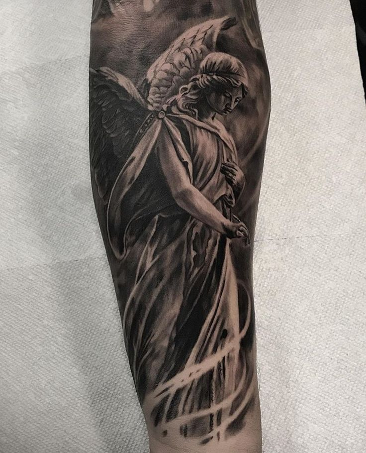 Black and grey realistic angel tattoo by brandon albus at