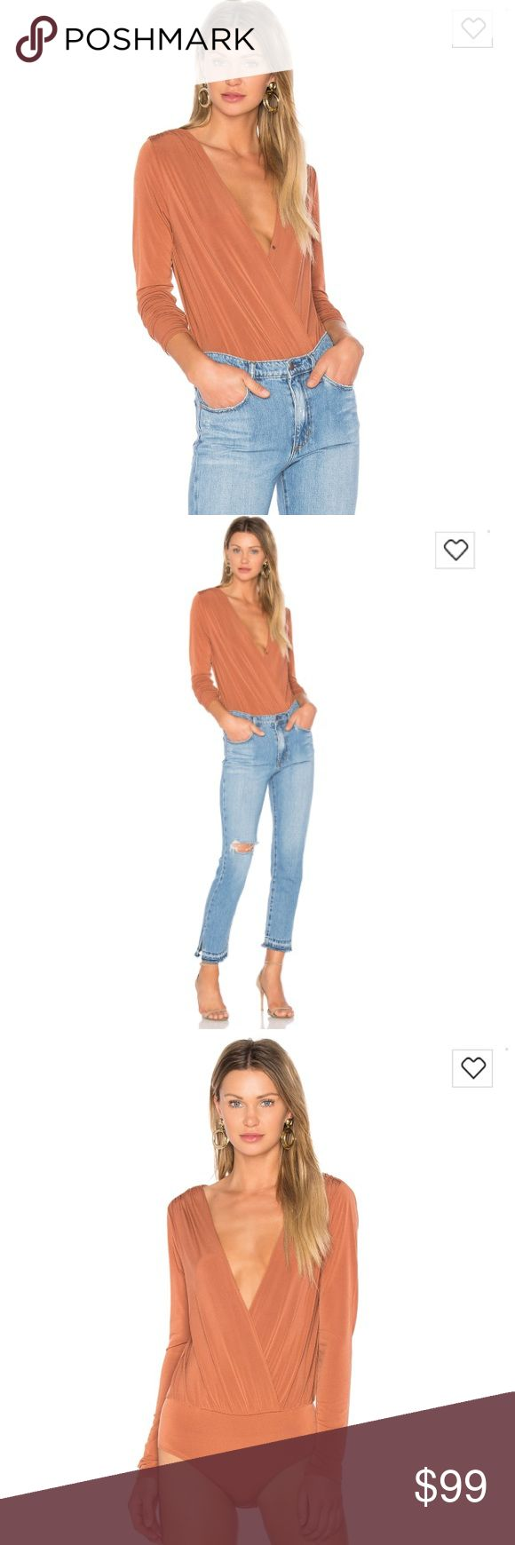 Brand new with tags BCBG deep V bodysuit Gorgeous brand new with tags never been worn. Beautiful orange ish copper tone color. No size listed but fits like a S/M BCBGeneration Tops