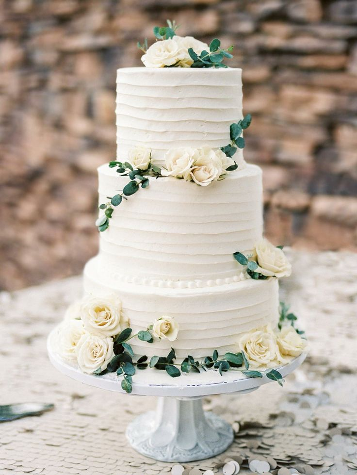 Wedding cake. Simple white and green. Natural