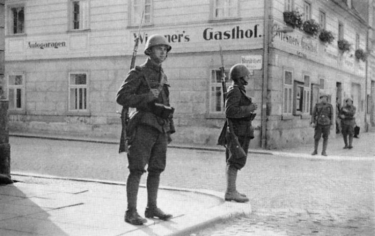 Czechoslovak soldiers patrolling the town of Krásná Lípa (German: Schönlinde) in the Sudeten Region, September 1938.