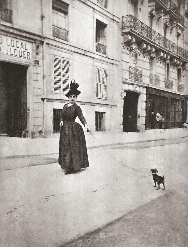 Woman with dog. Paris. Ca. 1890