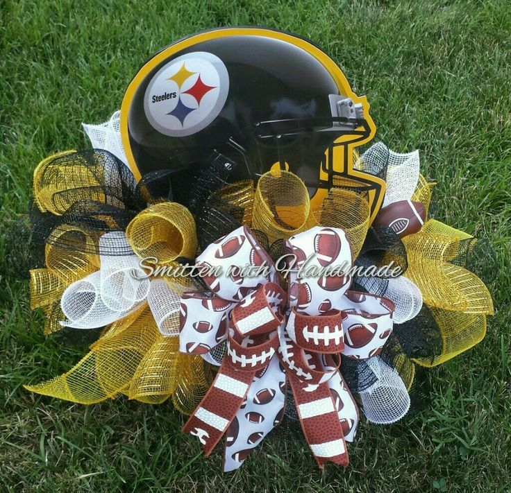 The ultimate cemetery saddle for your Pittsburgh Steelers fan angel! This cemetery saddle is built on an aluminum frame with poly deco mesh ruffles in Steelers colors, a bow made of different football ribbon, a wooden sign in a Steelers helmet design and a small vinyl football. Some also use these for a mailbox topper. PLEASE NOTE: TO PREVENT BREAKAGE DURING SHIPMENT, THE HELMET SIGN WILL BE WRAPPED IN BUBBLE WRAP SEPARATELY IN THE BOX AND WILL NEED TO BE REINSERTED IN THE S...