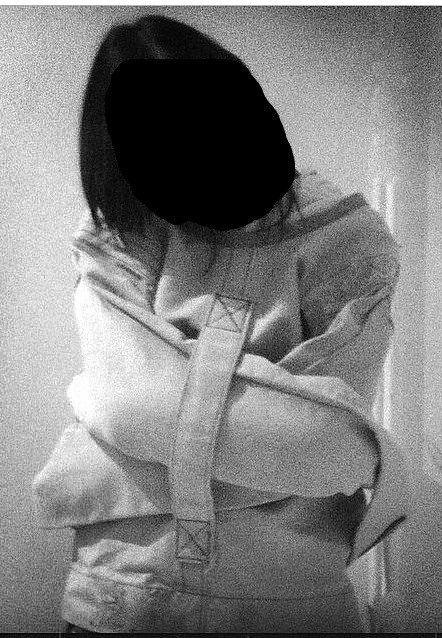 Woman in psychiatry in a Straitjacket Restraint,Frau in einer Psychiatrie Zwangsjacke Fixiert
