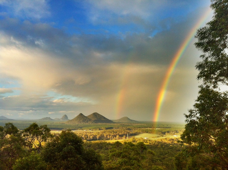 A magical moment over the Glasshouse Mountains , Qld taken from Uluramaya Retreat Cabins .