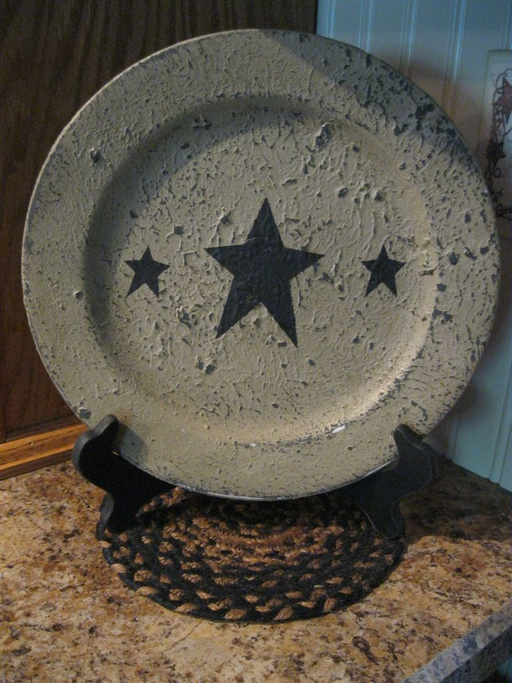 Primitive Plate.  Pick up some old plates from the thrift store.