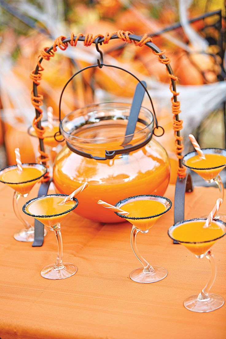 Vanilla vodka turns this orange crush punch into an adults-only Halloween treat.