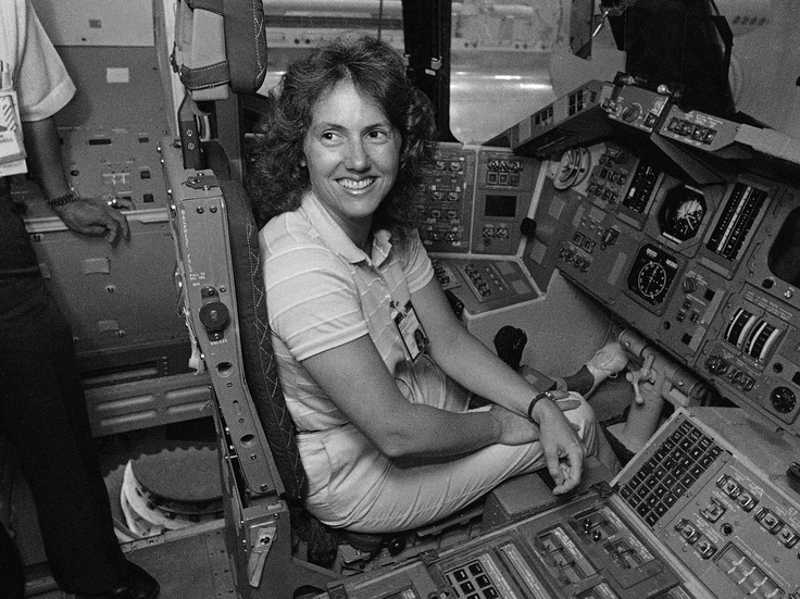 Christa McAuliffe tries out the commander's seat on the flight deck of a shuttle simulator at the Johnson Space Center in Houston, Texas, on September 13, 1985. McAuliffe was scheduled for a space flight on the Space Shuttle Challenger in January, 1986. (AP Photo)