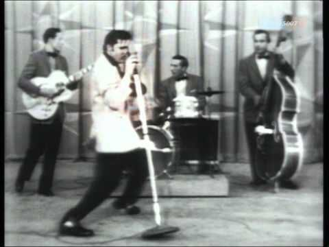Elvis: Hound Dog. (watch the whole utube to get your giggle on)