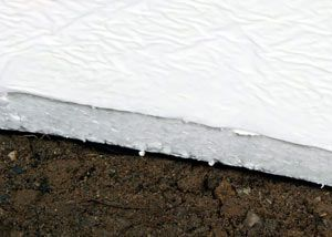 TerraBlock™ crawl space insulation was developed to meet the challenge of insulating rough, uneven crawl space floors. However, this innovative insulation is versatile enough to be used on foundation walls as well. The ¾-in.-thick sheet material is covered on both sides with a durable moisture barrier that makes the insulation resistant to puncture and abrasion damage.