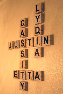 Family names with Scrabble tiles. Good idea for the concrete wall in our living room.