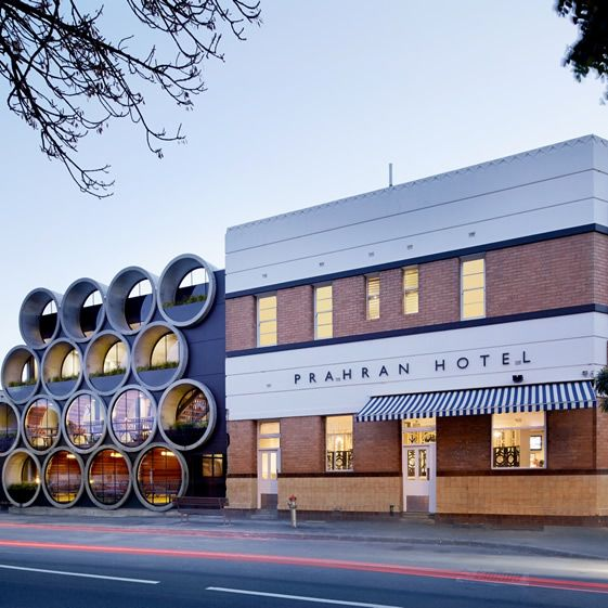 Those huge tubes that make up half the façade are certainly the dominant feature of the new-look Prahan Hotel – 17 of the custom made things weighing between four and seven tonnes each were lifted in over 11 days...