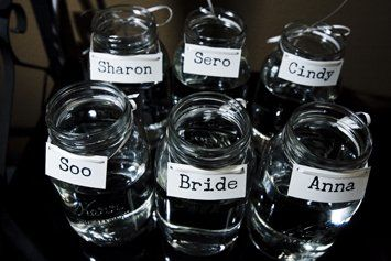 Mason jars ready for bridesmaid's bouquets... this lets your bouquets double as reception decor and that's just SMART!