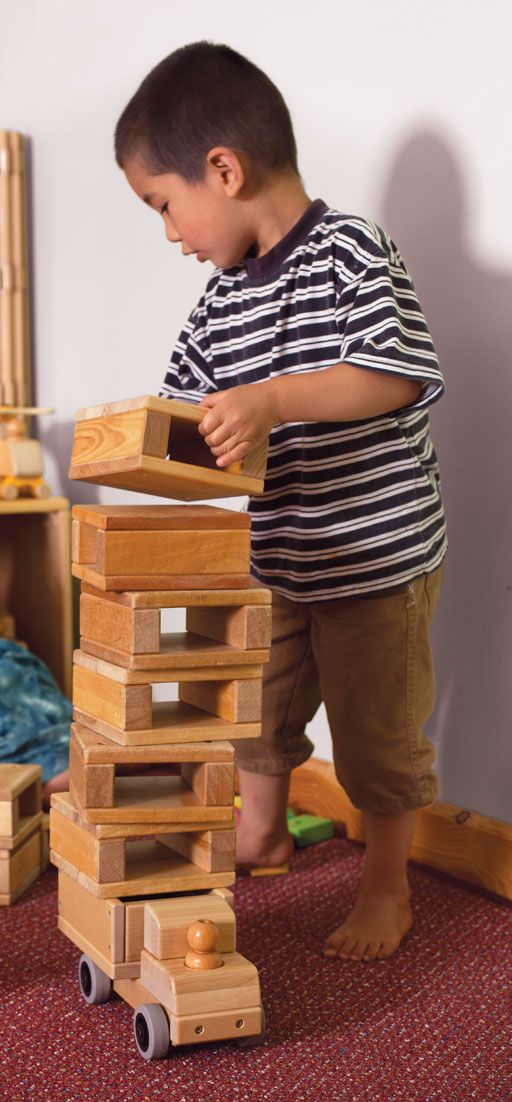 Block play fosters creative imagination as well as hands-on experience of maths and physics.