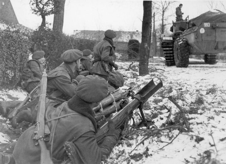 British Soldiers at the ready. The Soldier in the foreground is equipped with a PIAT Anti-Tank spring mortar.