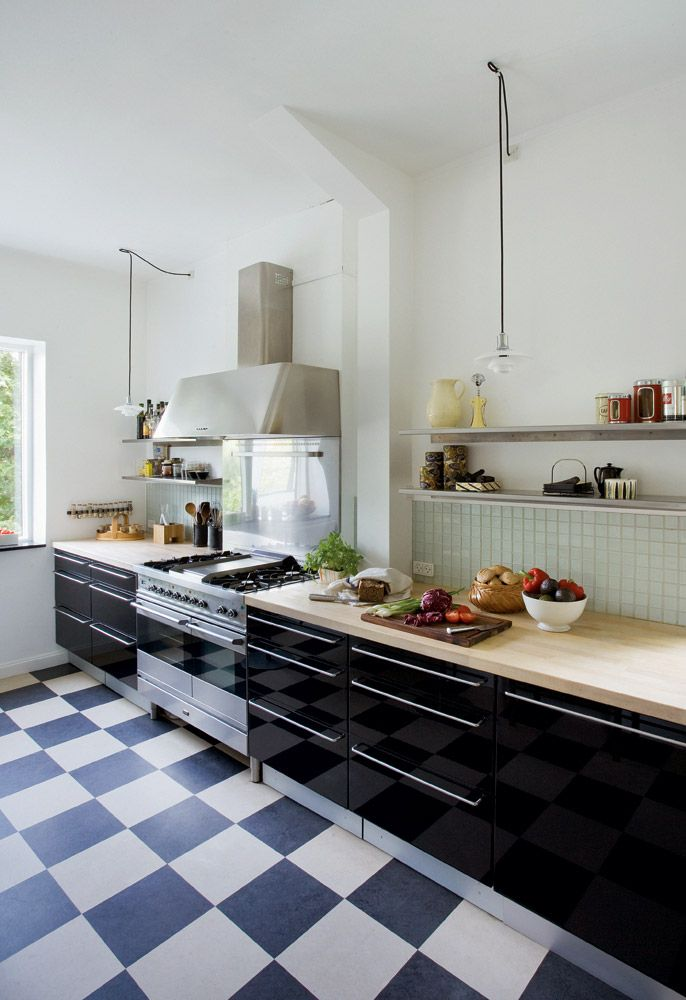 sleek cabinets open shelving and lots and lots of butcher block prep space floorsblack