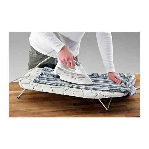 JÄLL Tabletop ironing board IKEA  Space saving as you can put it on the table and when you are finished, you can just hang it up with the hook underneath on a door or in the wardrobe.