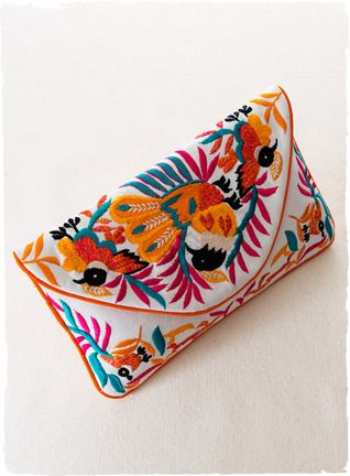 Peruvian Connection | Vibrant birds of paradise adorn the white cotton canvas envelope clutch.