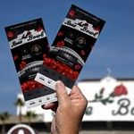 Jan 1, 2018; Pasadena, CA, USA; A fan holds game tickets for the 2018 Rose Bowl college football playoff semifinal game between the Oklahoma Sooners and the Georgia Bulldogs at Rose Bowl Stadium. Mandatory Credit: Kirby Lee-USA TODAY Sports