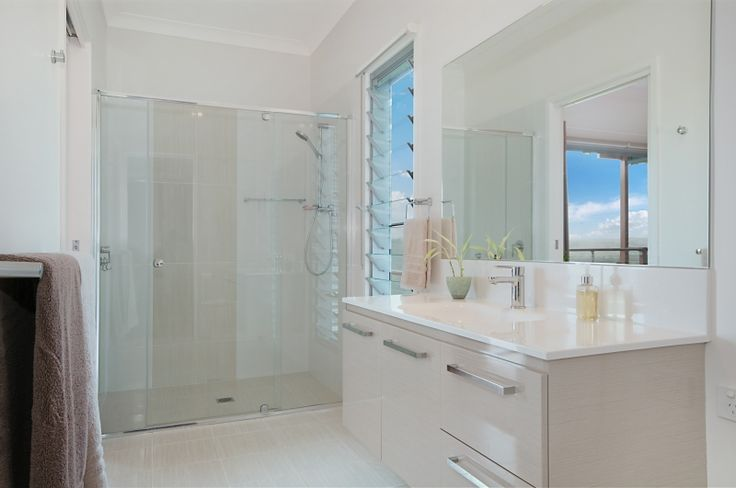 A simple neutral bathroom. We love the louvre window.  Floreat Park - Multi Split Level Home - www,delcasahomes.com.au #neutral #lourve #bathroom