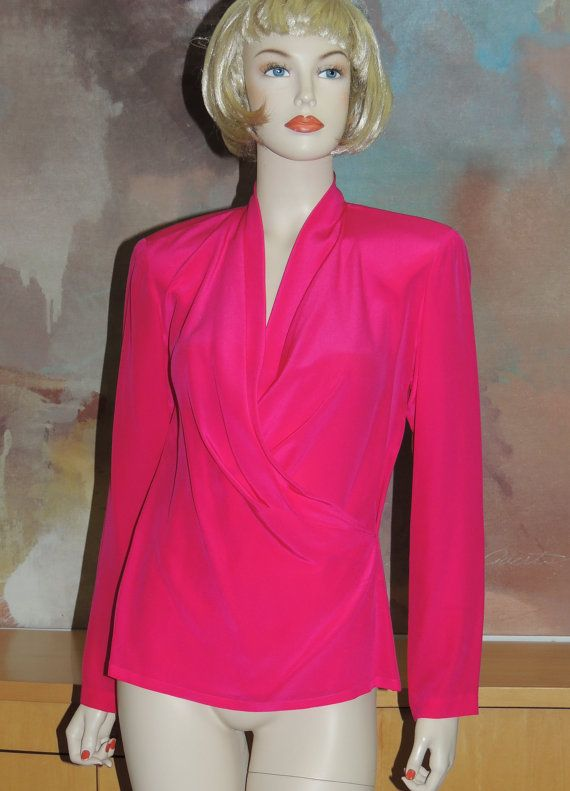 Linda Allard for Ellen Tracy, size 6 100% silk blouse. It was made in Hong Kong. The color is a fabulous fushia pink. The blouse has long