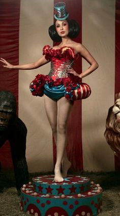 Showgirl on a kitschy pedestal!  Longer skirt... But for Kara, this outfit?…