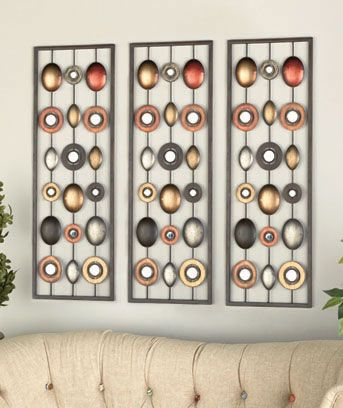 Make a bold statement with this Metal Wall Decor with Mirrors hanging in your home. You can mount it either vertically or horizontally. It features ovals and circles in a variety of finishes for an instant update to your decor. The accent mirrors