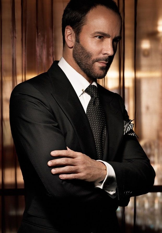 Tom Ford in a classic black suit and tie
