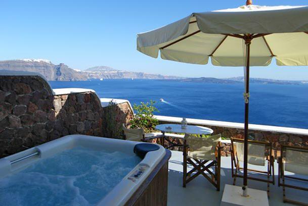Delfini Villas Santorini Hotel in Oia - A private veranda with jacuzzi  http://www.delfinihotel.net/