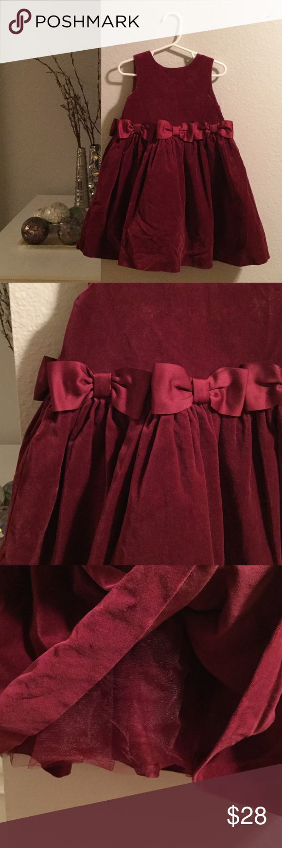 Janie and Jack velvet dress Janie and Jack gorgeous wine-colored velvet sleeveless dress with tonal bows at the waist (continue around the back of the dress) and tulle underneath to create fullness. Buttons up the back. Excellent condition - like new except for perhaps a few small wrinkles that need to be ironed out. Worn once to a wedding. Janie and Jack Dresses Formal