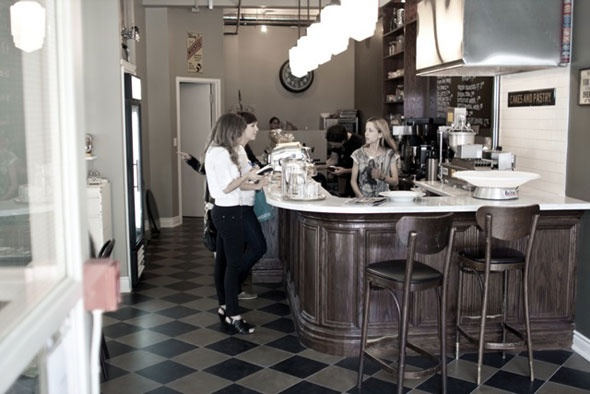 Little Nickys Coffee has a retro feel with muted colours, soft lighting, checkered tiles and glass cookie jars. #tbex