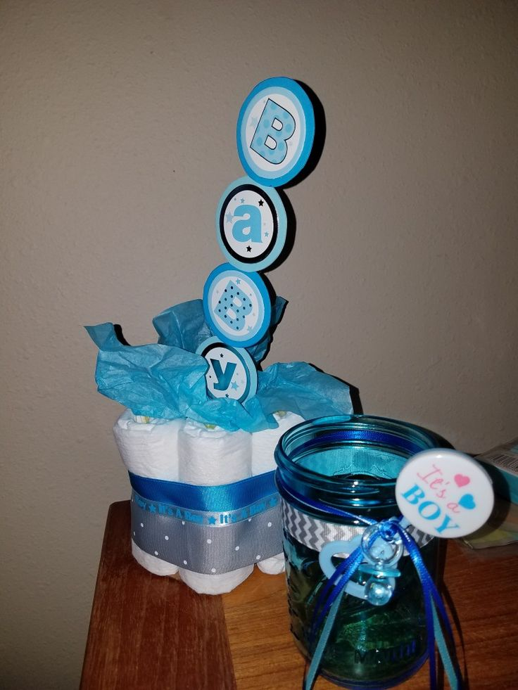 centerpieces... small diaper cake  blue mason jar just need to place babies breath