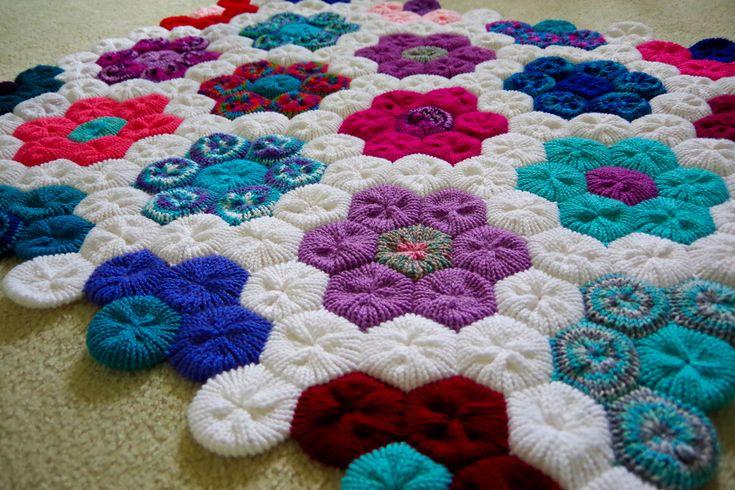 Hexagon Flower Afghan by Yay For Yarn Patterns - http://yayforyarn.com/addi-express-knitting-machine-tutorials/how-to-make-the-hexagon-flower-afghan-on-your-addi-express-professional-knitting-machine/
