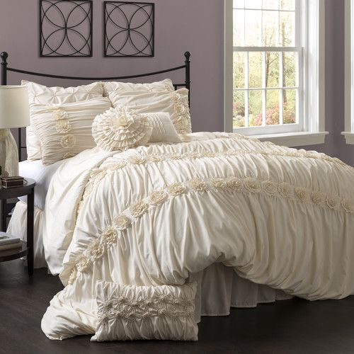 Features:  -Cleaning & Care: Dry clean only.  -Construction Material: Polyester cover and fill.  -Set includes: comforter, bed skirt and two shams.  Product Type: -Comforter/Comforter set.  Style: -Co