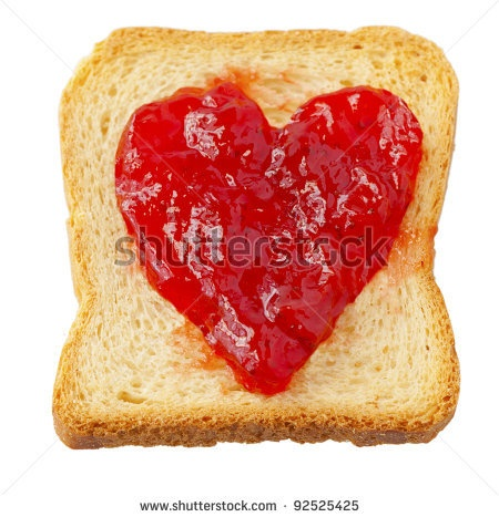 stock photo : Rusk with strawberry jam in shape of heart