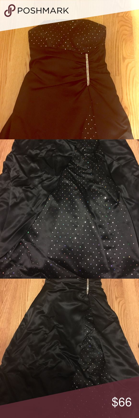 Black evening dress Blondie Nites by Linda Bernell strapless black dress with polka dots in shimmery silver and a strap back. Has a piece of rhinestone to hold it together, very beautiful dress 😊 no signs of wear, however the smallest little white mark on it, but not noticeable at all when I zoomed out. You have to like really look closely to even notice it. I purchased a Dillard's a few years back. Dillard's Dresses